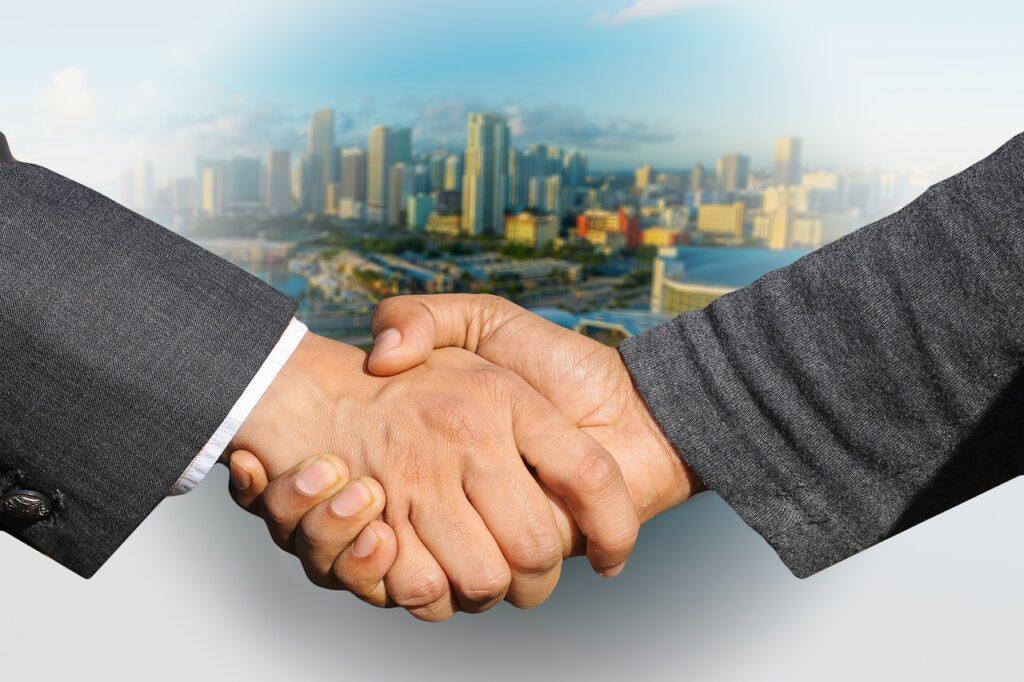 shaking hands, handshake, skyline-3213665.jpg